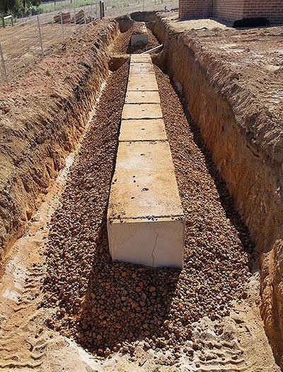 Leach drains prepared with drainagerock