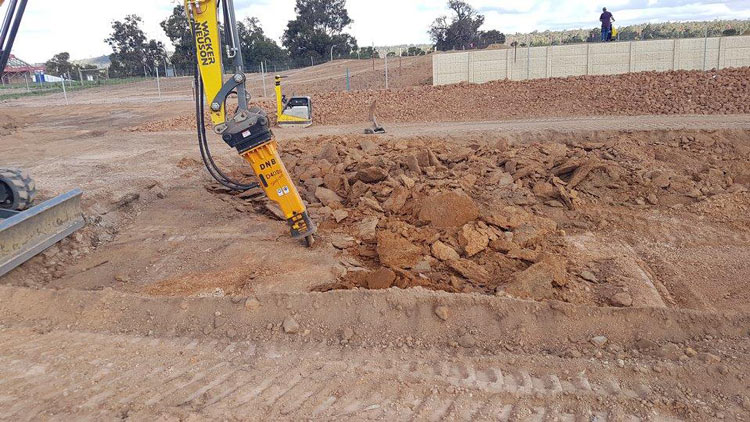 Using our rock breaker to prepare ground for a house pad